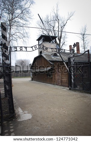 Auschwitz in Winter Fog Entrance from Behind