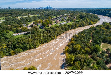 Austin Flooding aerial drone view of Flooded Colorado River with Austin , Texas , USA city skyline in the background October 2018 Stock photo ©
