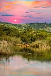 Austin Roberts Bird Sanctuary on a lake sky reflection during sunset in Pretoria South Africa