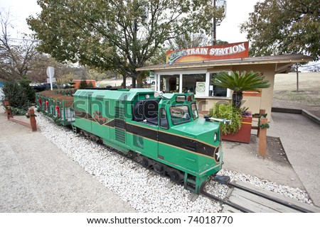AUSTIN, TEXAS - DECEMBER 7: The Zilker Zephyr train is parked at the train station on December 7, 2010 in Zilker Park, Austin, Texas. The Zephyr takes riders on a scenic ride around Zilker park.
