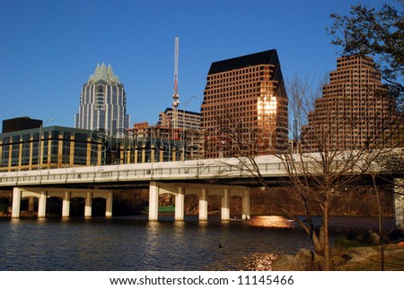 Austin, Texas downtown skyline at sunset, embraced by the beauty of Lady Bird Lake.