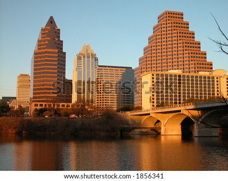 Austin, Texas downtown skyline at sunset, embraced by the beauty of nature. Austin downtown is next to the colorado river's infamous Town Lake.