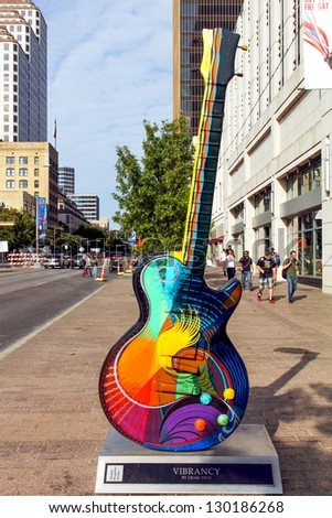 "AUSTIN, TEXAS - NOVEMBER 18 : "" Vibrancy""  by Craig Hein, one of the Guitar town Austin art project Guitars on Congress Ave. as seen during the Formula One Fan Fest November 18 2012."