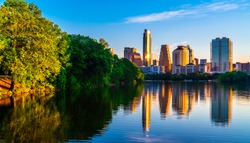 Austin Texas perfect mirrored reflection against Texas Hill country trees Cityscape Skyline April 2018 capital city downtown Riverside pedestrian bridge reflection along Town Lake golden hour sunrise