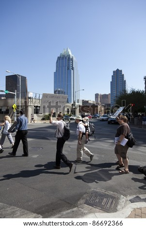 AUSTIN, TX - OCTOBER 15: An unidentified group of protestors carry signs along Lavaca Street during the 'Occupy Austin' march to the Texas State Capitol on October 15th, 2011 in Austin.