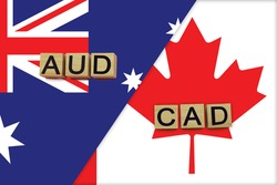 Australia and Canada currencies codes on national flags background. International money transfer concept
