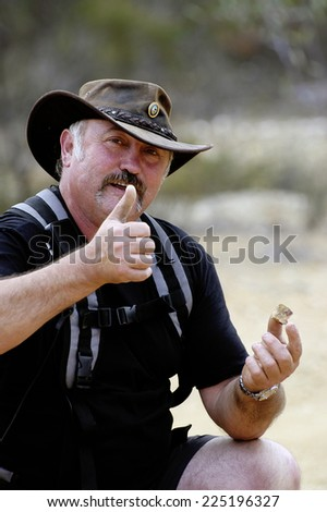 AUSTRALIA - APRIL 24: A gold miner in Australia happy to have found a piece of quartz containing gold, April 24, 2007