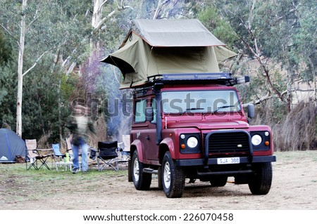 AUSTRALIA - APRIL 21: All-terrain vehicle equipped for camping with a tent on the roof handy for sleep safely, April 21, 2007.