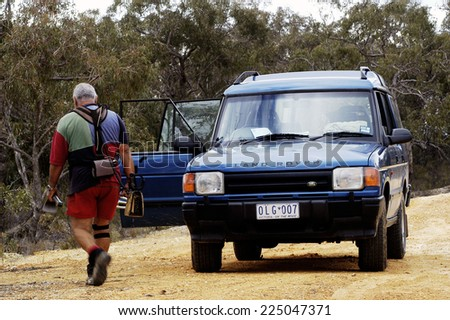 AUSTRALIA - APRIL 24: Australia gold miner returning to its off-road vehicle in which there is the fresh drinks, April 24, 2007.