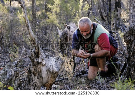 AUSTRALIA - APRIL 23: Gold miner at work detecting gold nuggets with a metal detector, April 23, 2007