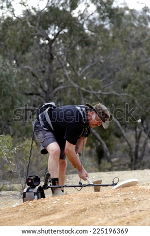 AUSTRALIA - APRIL 24: Gold miner at work detecting gold nuggets with a metal detector, April 24, 2007