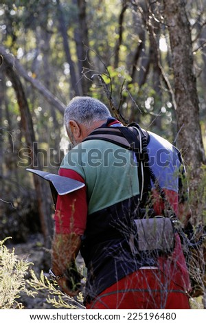 AUSTRALIA - APRIL 23: Gold miner at work detecting gold nuggets with a metal detector., April 23, 2007