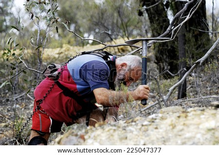 AUSTRALIA - APRIL 24: The hollow gold miner with his pick of where the detector indicated the possible presence of a nugget of gold in the ground, april 24, 2007.