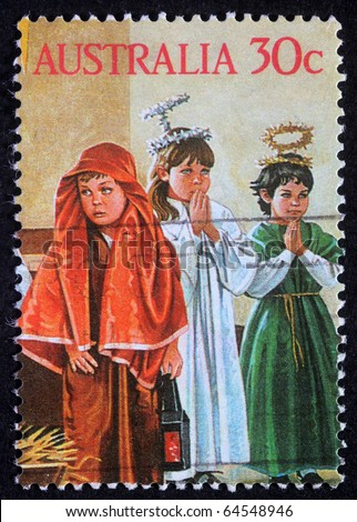 AUSTRALIA - CIRCA 2004: A greeting Christmas stamp printed in Australia shows children play to the Holy Family, circa 2004