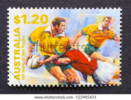 AUSTRALIA - CIRCA 1999: A  postage stamp printed in Australia showing an image commemorative of 100 years of rugby, circa 1999. - stock photo