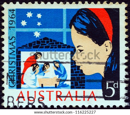 "AUSTRALIA - CIRCA 1964: A stamp printed in Australia from the ""Christmas "" issue shows a child looking at Nativity Scene, circa 1964."