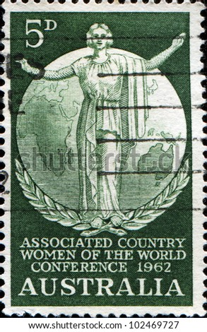AUSTRALIA - CIRCA 1962: A stamp printed in Australia honoring Associated Country Women of the World Conference, shows woman on background of globe, circa 1962