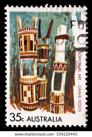 AUSTRALIA - CIRCA 1971: A stamp printed in Australia shows Aboriginal art - Grave posts, circa 1971