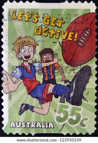 "AUSTRALIA - CIRCA 2009: A stamp printed in Australia shows Australian Rules Football, ""Let's Get Active!"", circa 2009"