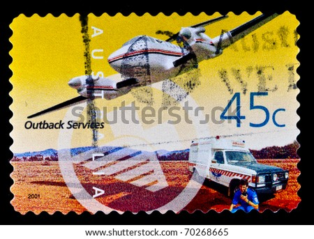 AUSTRALIA - CIRCA 2001: A stamp printed in Australia shows terrestrial services officer is sitting near the car and leads by radio talks to the pilot flying the aircraft, circa 2001