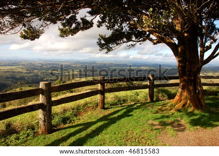 Australia countryside from a lookout with tree and fence