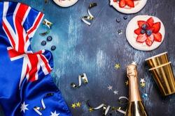 Australia Day. Australia National Day background with Australia National Flag, dessert pavlova cakes on white. Copy space