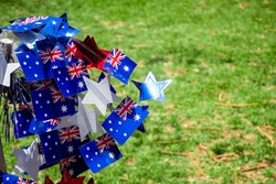 Australia Day decorations - flag and blue, red and white stars on a green grass background. Happy Australia day