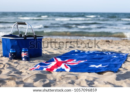 Australia day themed pictures with flag beach towel, small dog and flags