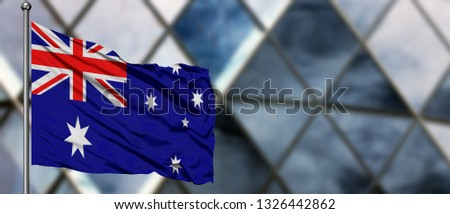 Australia flag waving in the wind against blurred modern building. Business concept. National cooperation theme. #1326442862