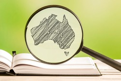 Australia information with a pencil drawing of a australian map in a magnifying glass