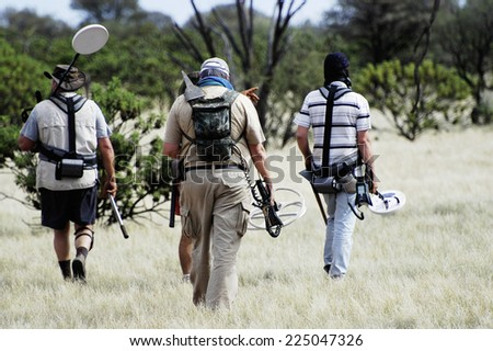 AUSTRALIA - MAY 6: Departure of a small group of gold miners equipped with metal detectors and picks at dawn looking for gold nuggets, may 6, 2007.