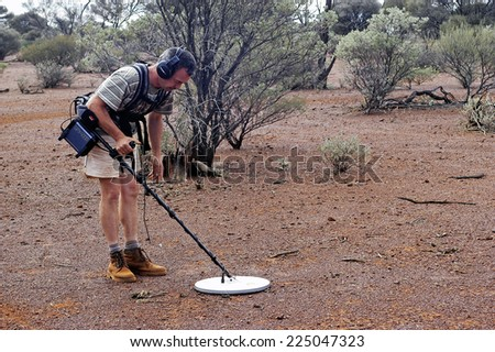 AUSTRALIA - MAY 13: Gold miner in the Australian outback prospecting area in the bush with his metal detector looking for gold nuggets, may 13, 2007.