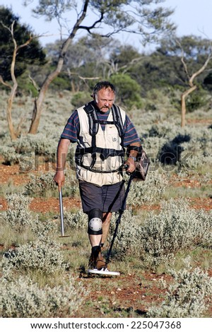AUSTRALIA - MAY 10: Gold miner in the Australian outback prospecting area in the bush with his metal detector looking for gold nuggets, may 10, 2007.