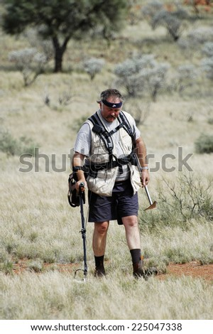 AUSTRALIA - MAY 6: Gold miner in the Australian outback prospecting area in the bush with his metal detector looking for gold nuggets, may 6, 2007.