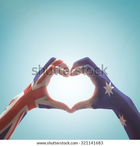 Australia national flag  on people hands in heart shape isolated on sky background for labour day and national Anzac holiday celebration     #321141683