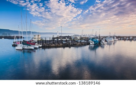 australia protected bay still water sunrise time fishing boats at piers around lighthouse industrial fleet nautical business