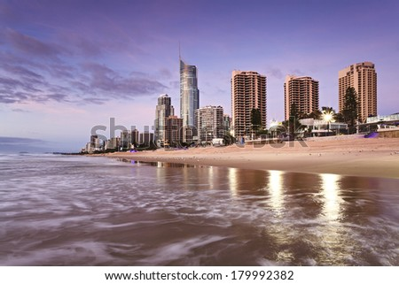Australia Queensland Surfers Paradise CBD beach side at sunrise from North ocean surfing waves reflecting skyscrapers and Q1
