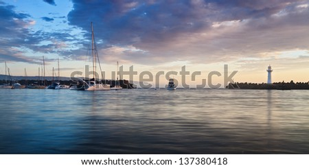 australia sea port harbour at sunrise marina protected area with lighthouse and fishing boat exiting
