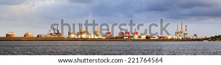 australia sydney botany bay cargo port panoramic view with cranes, containers, derricks and heavy dock equipment in a waterfront