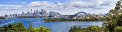 Australia Sydney city CBD scenic view from Taronga Zoo at landmarks and harbour bridge over harbour waters sunny summer day