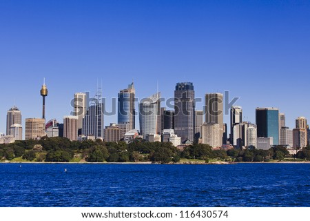 Australia Sydney City CBD sunny day view from harbour ferry summer blue sky and harbor water cityline