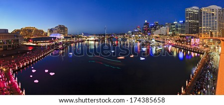 Australia Sydney Darling harbour still blurred water of coockle bay at sunset with illuminated buildings, hotels and tourism attractions