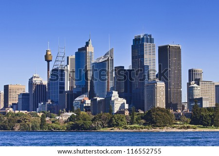 Australia Sydney downtown CBD towers and skyscrapers view from ferry over Royal Botanic Garden bright summer sunny day