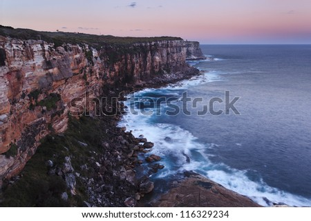 Australia Sydney north head east side sunset view to pacific ocean surf under pink sky and surf waves