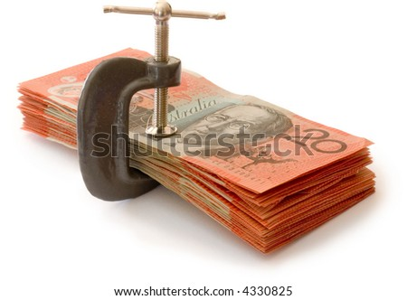 australian banknotes in a g-clamp, metaphor for restriction on spending - stock photo