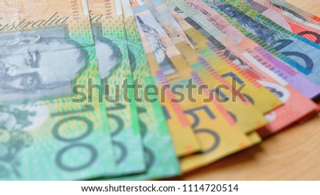 Australian currency closeup of fives, tens, twenties, fifties and one hundred notes, shallow DOF. #1114720514
