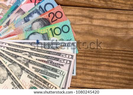 Australian dollars and US dollars on the table