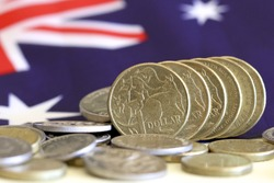 Australian dollars with Australian flag background.