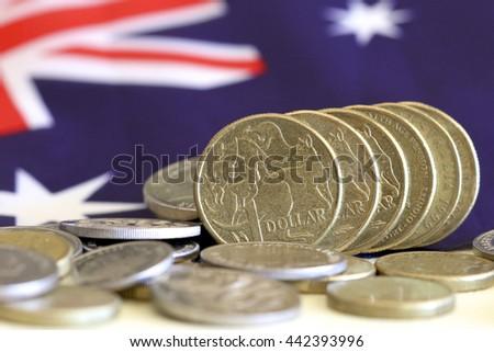 Australian dollars with Australian flag background. #442393996