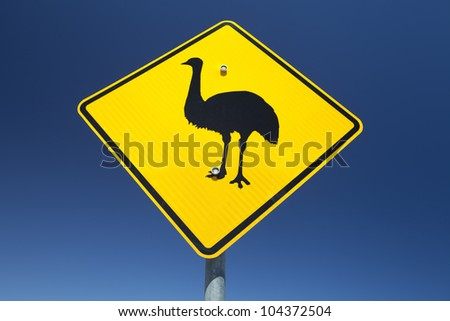 Australian Emu warning sign against a vibrant blue sky